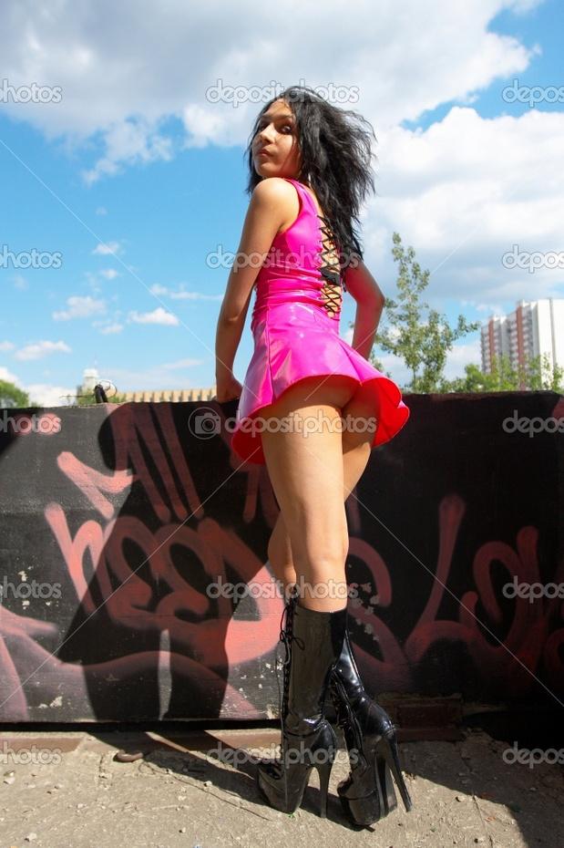 Girl in latex dress. Upskirt.; Uniform
