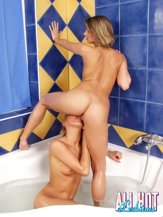 Two sandy blonde lesbians licking their fuckable pussies in the bat tub; Lesbian Teen